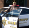 Sheriff Mike Raines with his Sheriff Car.